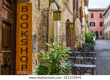English bookshop in Tuscany near a restaurant along a nice alley - stock photo