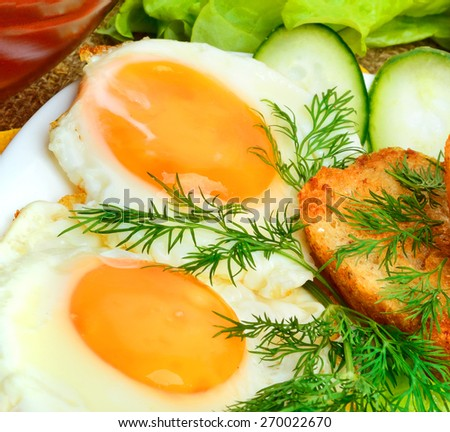English breakfast, scrambled eggs with toasts and vegetables. Salad with cabbage, cucumber. - stock photo