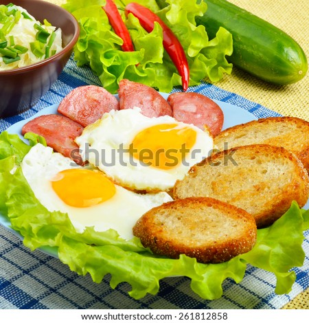 English breakfast - toast, egg, bacon and vegetables. Salad, cabbage, cucumber. - stock photo