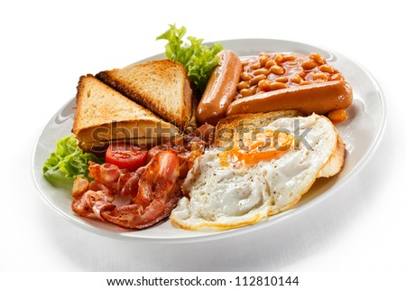English breakfast - toast, egg, bacon, sausages, beans and vegetables on white background - stock photo