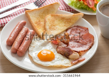 English breakfast with coffee on wood table. - stock photo