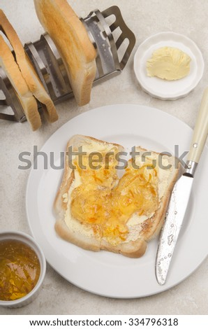 english breakfast with toast, orange marmalade and butter - stock photo