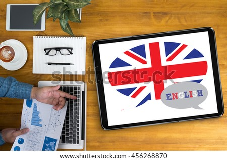ENGLISH ( British England Language Education ) Businessman working at office desk and using computer and objects, coffee, top view,