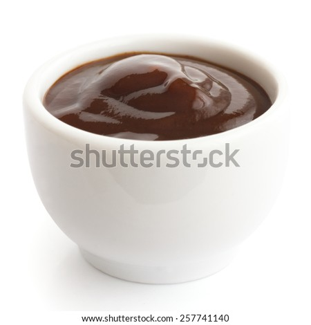 English brown sauce in small white dish. - stock photo
