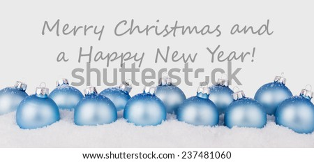 english Christmas card with blue christmas balls and text Merry Christmas and a happy New Year/Merry Christmas and a happy New Year/english - stock photo