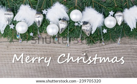 english Christmas card with Pine green,  baubles and angel wings  and text Merry Christmas/Merry Christmas/english - stock photo