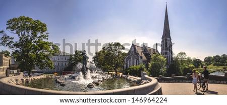 English church (Church of Saint Alban) and fountain in Copenhagen, Denmark - stock photo