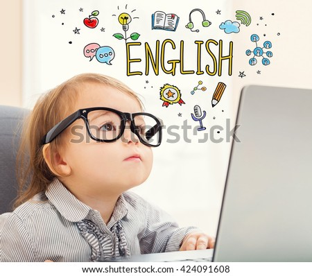 English concept with toddler girl using her laptop - stock photo