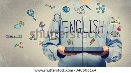 English concept with young man holding a tablet computer  - stock photo