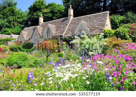 English Country Cottage With Beautiful Flowers Garden In The Sunshine Cotswolds England UK