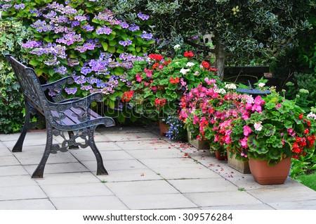 English country garden rustic patio area - stock photo