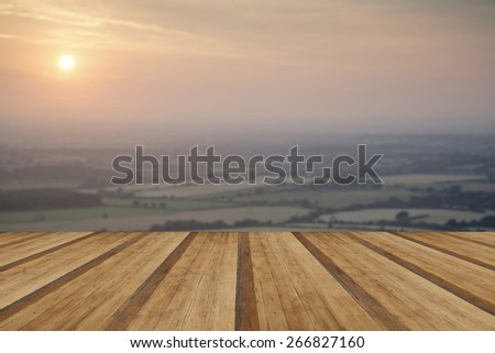 English countryside landscape during late Summer afternoon with wooden planks floor