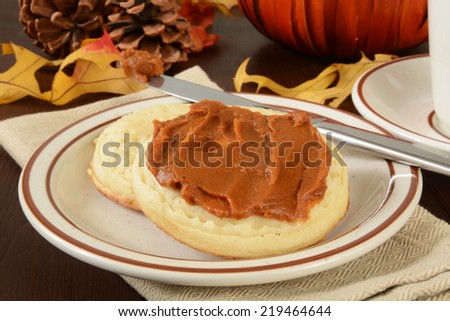 English crumpets with pumpkin butter spread on top - stock photo