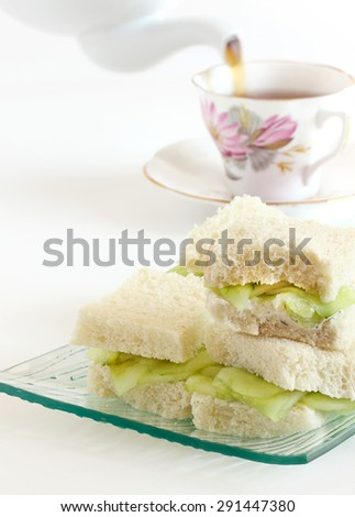 English cucumber sandwiches with tea - stock photo