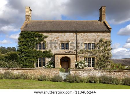 English farmhouse, Gloucestershire - stock photo
