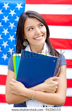 English female student with the American flag at the background - stock photo