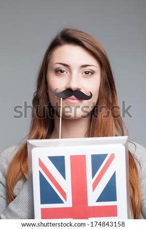 English female student with the British flag  - stock photo
