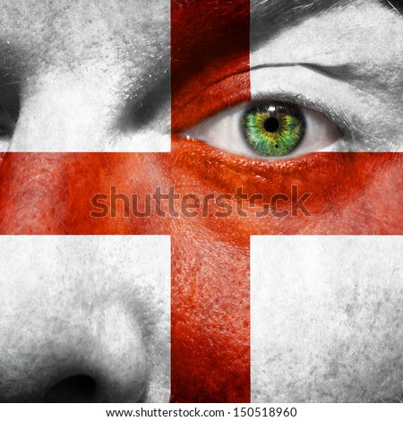 English flag painted on mans face to support his country England - stock photo