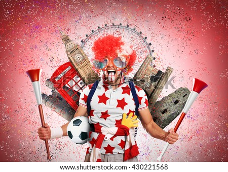 English football fan in a red wig and horns - stock photo