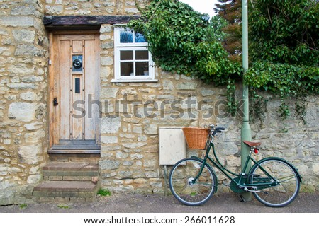 English front cottage with bicycle - stock photo