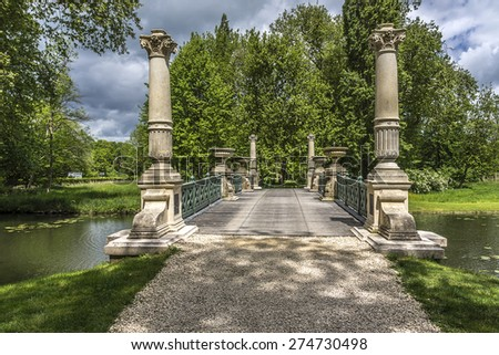English Garden (Jardin Anglais, 1817). Famous Chateau de Chantilly (Chantilly Castle, 1560) - historic chateau, town of Chantilly, Oise, Picardie, France. - stock photo