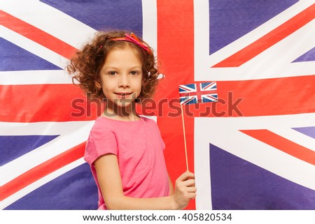 English girl with flag in front of British banner