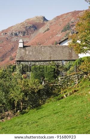 English hill farm house - stock photo