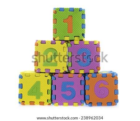 English language letter created from Alphabet puzzle isolated on white background - stock photo