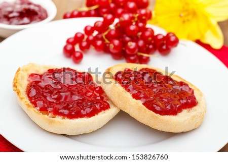 english muffins with red currant jam. - stock photo