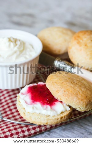 English pastries: scones with strawberry jam and cream cheese for breakfast, selective focus