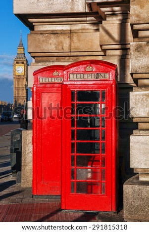 English red telephone booths with Big Ben in London, UK - stock photo