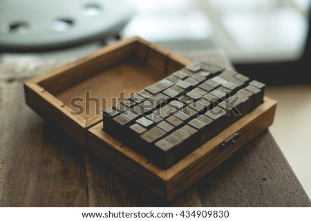 English rubber stamps in the wood box. - stock photo