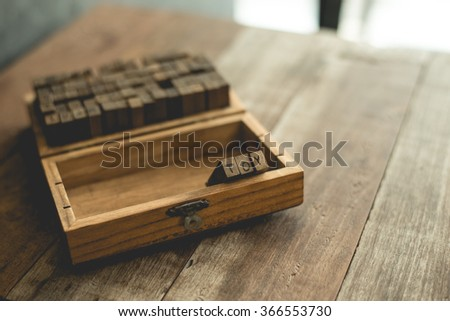 English rubber stamps the word toy in wood box. - stock photo