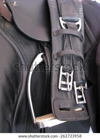 English saddle, girth and stirrups - stock photo