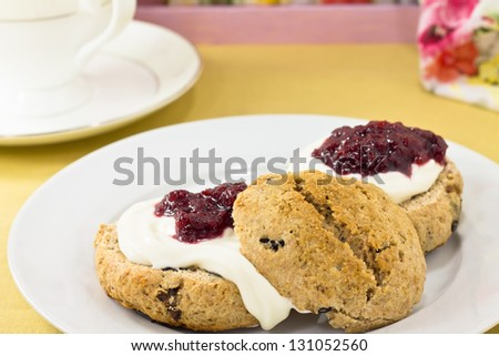 English scones  of whole wheat  with clotted cream and strawberry jam