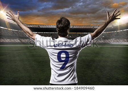 English soccer player, celebrating with the fans. - stock photo
