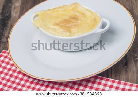 English style cottage pie presented in individual white ceramic pot
