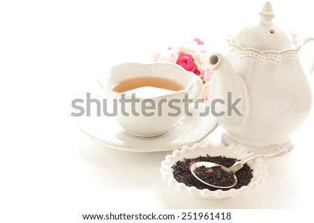 English tea, black tea leaves and rose - stock photo