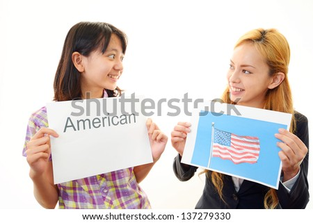 English teacher with girl studying. - stock photo