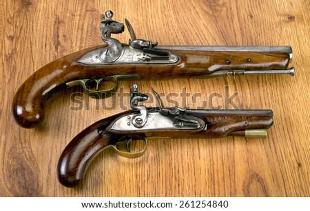 English 18th century flintlock pistols. - stock photo