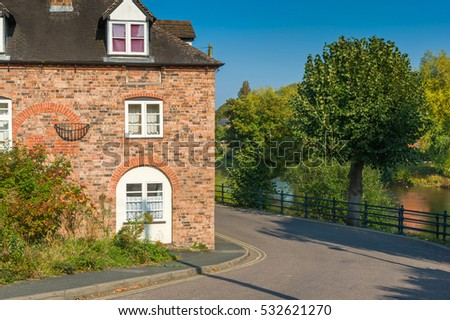 English village street with bricked residential building.