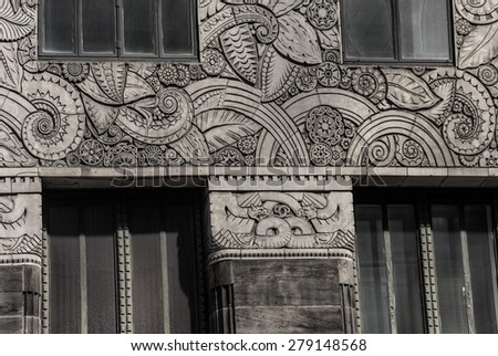 Engraved classic designs on the exterior of this building in mid-town Manhattan. - stock photo