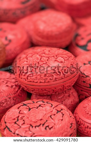 Engraved egg-shaped red boxes, Panjiayuan Flea Market, Beijing, China - stock photo