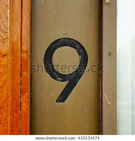 Engraved house number nine - stock photo