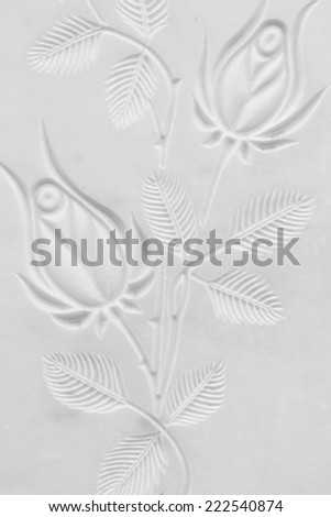 engraved roses decoration on cemetery marble slab - stock photo