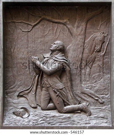 Engraving on the side of the Federal Building  that shows a praying George Washington