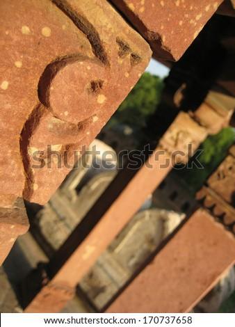 Engravings on a building pillar in Delhi, India - stock photo