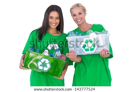 Enivromental activists holding box of recyclables and smiling on white background