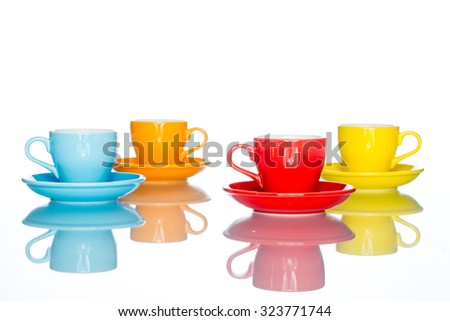 enjoy multiple colorful coffee cup mug on reflection table white  background - stock photo