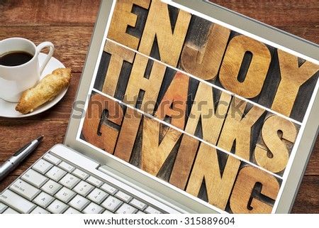 Enjoy Thanksgiving  - word abstract in vintage letterpress wood type blocks on a laptop screen - stock photo
